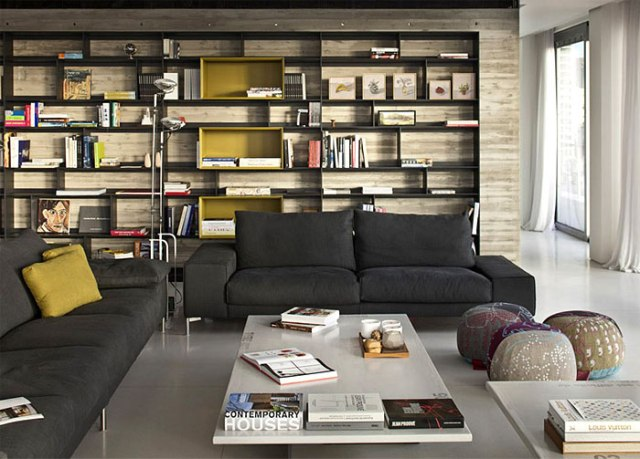 tel-aviv-penthouse-dark-metal-bookcase-raw-concrete-wall
